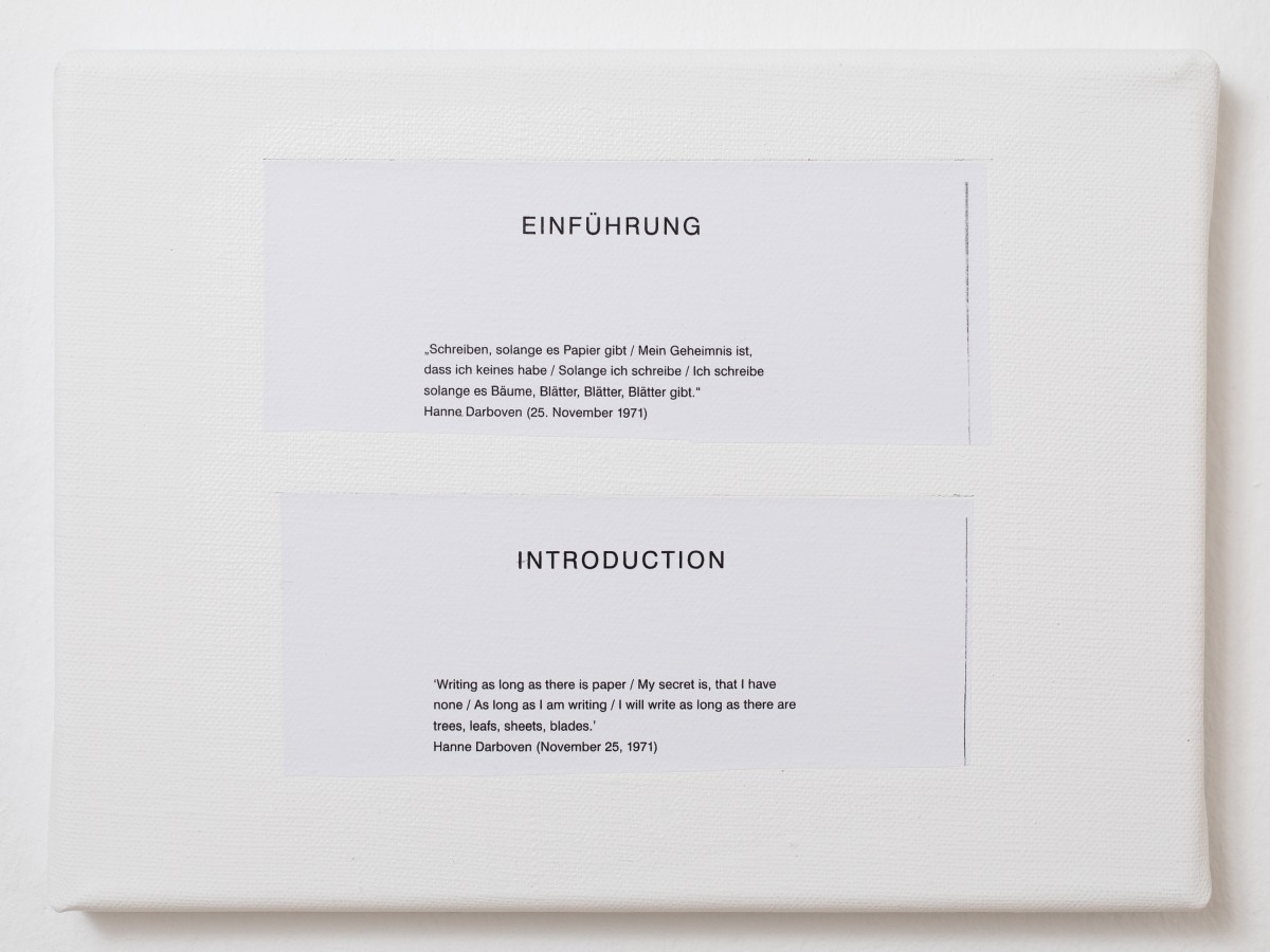 It is a small white canvas. On it there are two cut-out quotations. They were glued on it by the artists.